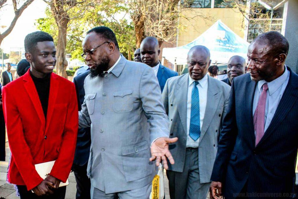 Honourable Minister Doctor Lazarus Dokora Chatting with Kudakwashe Maxwell